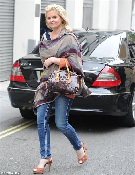 Pasmina Denim C danniella westbrook pulls a grimace as she battles the wind daily mail