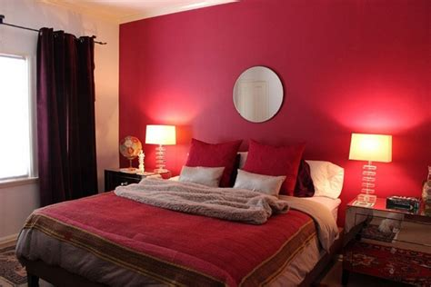 red wall bedroom contemporary bedroom with red wall paint circle mirror