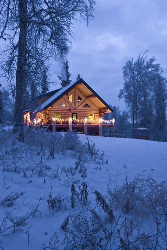 log cabin   woods decorated  christmas lights