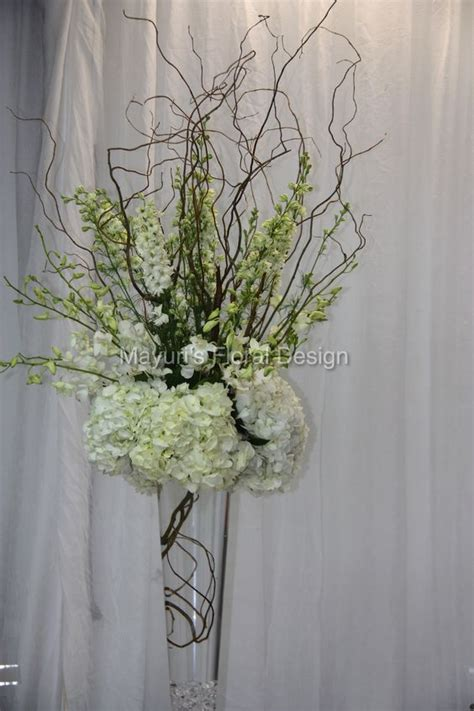 vase floral design and curly willow on