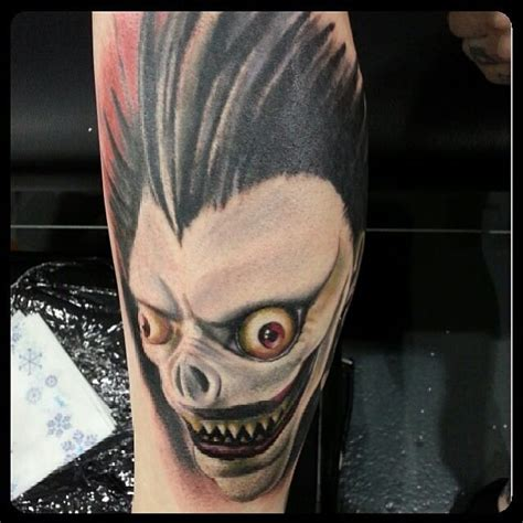 death note tattoo 10 chilling note tattoos of ryuk the shinigami