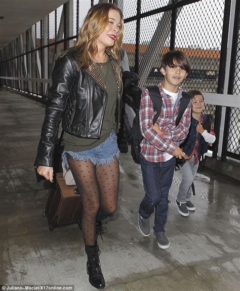 Country Boots Covey leann rimes wears to fly to seattle
