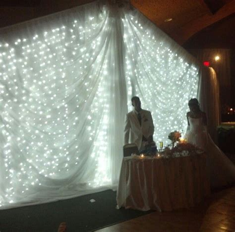 light backdrop for wedding table can diy by draping