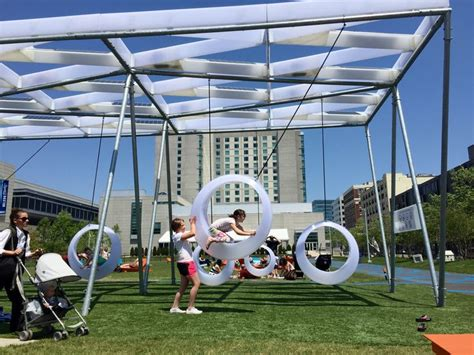 swing and the city behind the hulking boston convention center the city is