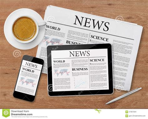 mobile phone news news page on tablet mobile phone and newspaper stock