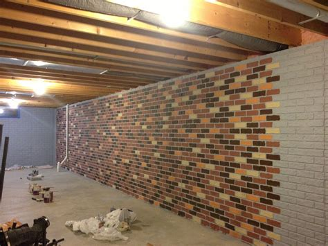 poured basement painted to look like brick basement the seams on a sted concrete wall disappear when the