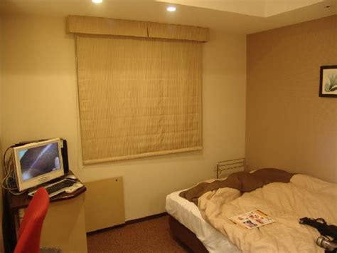 semi double bed mini kitchenette and refrigerator picture of tokyu stay