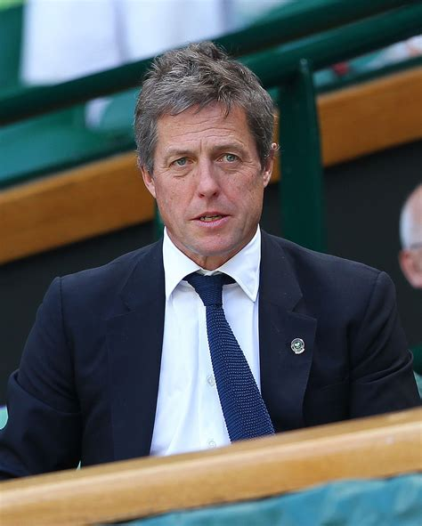 Demented Reporter Handcuffs Herself To Hugh Grant by Hugh Grant Go Fug Yourself
