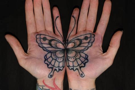 two palm tattoos that combine to become one butterfly