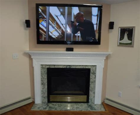Flat Screen Above Fireplace by Flat Screen A Fireplace With Bose Acoustimass Sound
