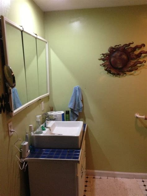 how do i brighten my windowless bathroom