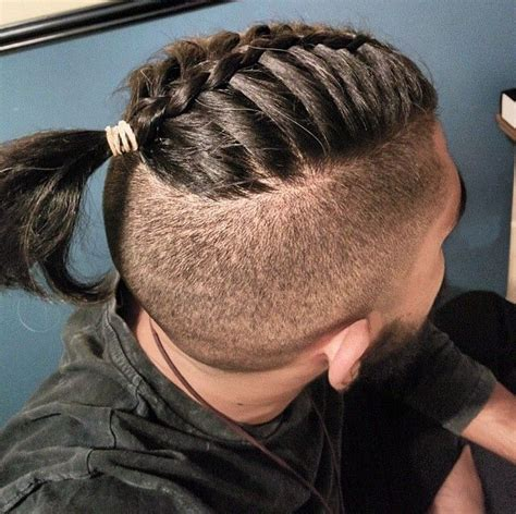 top knot hairstyle for men the man bun braids a surprising new men s hair trend