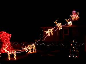 reindeer pulling santa s sleigh holiday christmas lights