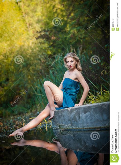 Set Dress Forest Blue Setelan in a blue dress at sunset in a forest stock photo image 28815412