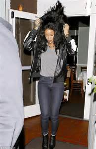Rihanna clutches her top to avoid a wardrobe malfunction   Daily Mail Online