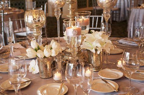 elegant ivory wedding flowers tulips lillies mercury glass
