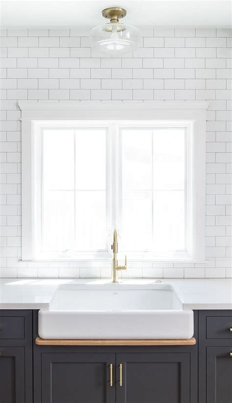 white subway tile with light gray grout new kitchen trend dark cabinets subway tile
