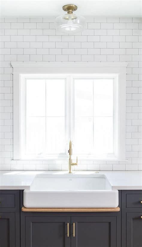 white subway tile backsplash classic english looks in los hot new kitchen trend dark cabinets subway tile