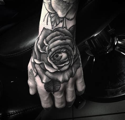 tattoo parlor kings cross eye see you realistic rose hand tattoo done by snappy