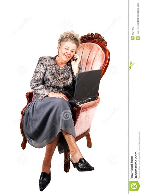 woman in armchair business woman in armchair royalty free stock images
