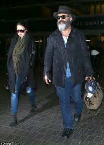 mel gibson locks lips with 24 year old girlfriend rosalind ross in mel gibson 60 jets into lax with girlfriend rosalind