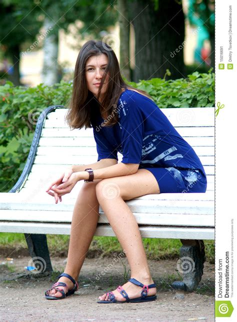 woman sitting on bench woman sitting on a bench stock image image 15016691
