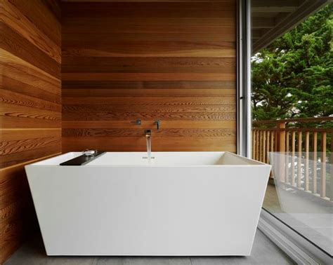 wood walls in bathroom creating a natural feel with wood in contemporary bathrooms