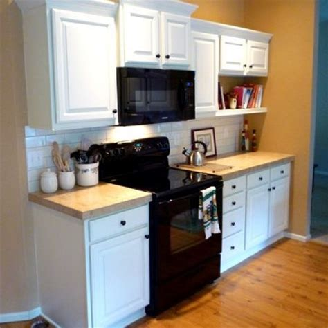 Kitchen White Cabinets Black Appliances Photos Before And After Kitchen Remodels