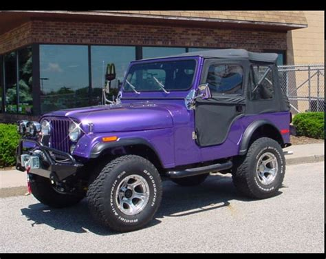 jeep purple purple jeep with black top stuff i