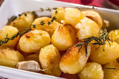 how to cook the perfect roast potatoes for christmas day with our three tasty recipes
