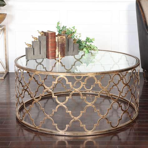 uttermost quatrefoil gold coffee table on sale