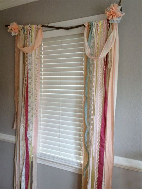 shabby chic rustic rag curtain window treatment panels attached to branch anthropologie