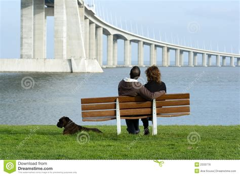couple sitting on bench couple sitting on a bench stock photo image of lovers
