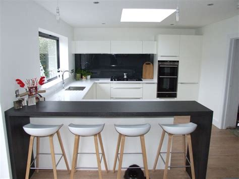 Breakfast Bar Tops by This Striking White Kitchen Consists Of Matt White