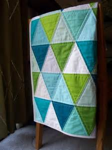 made to order modern triangle baby quilt in aquas blues