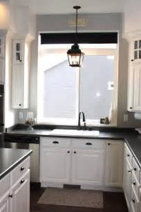 Kitchen Sink Light Fixtures Adorable Above Kitchen Sink Lighting Ideas Using Candle Shaped Led Bulbs Inside Pendant Lantern