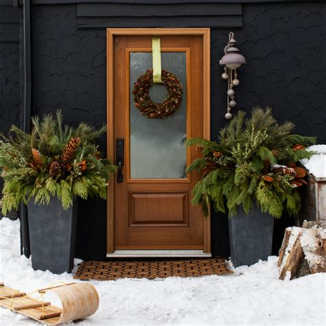 christmas decorating huge stone urns in front of entrance 19 outdoor decorations