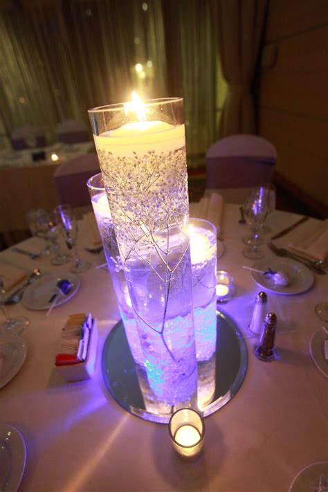 wedding centerpieces with purple led lights and