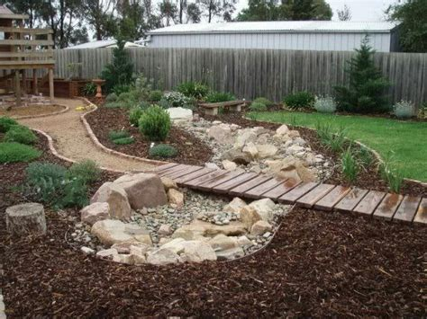 dry creek bed for yard on pinterest landscaping