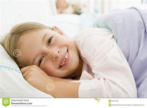 lying down in bed young girl lying down in her bed royalty free stock photography image 6441287