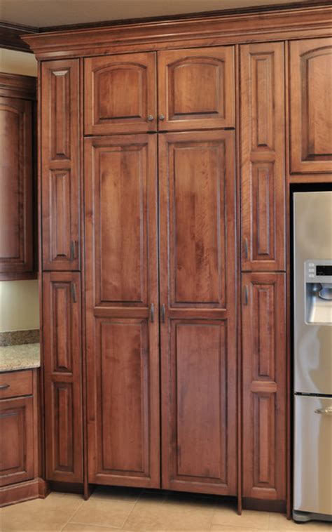 Birch cabinetry with cherry stain/finish.   Traditional