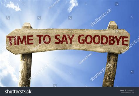 12 Signs Its The Right Time To Say I You by Time To Say Goodbye Wooden Sign On A Beautiful Day Stock