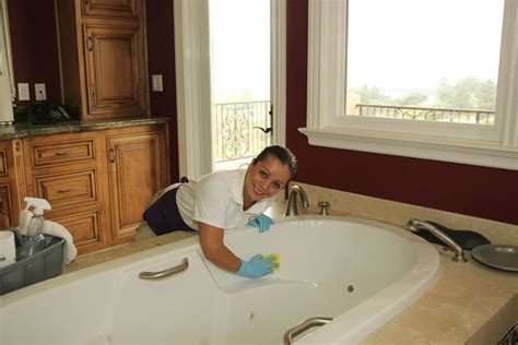 maid in bathroom cleaning services sparkly cleaners