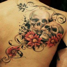 tattoo goo cover up skull tattoo with flowers for more skull tattoos visit