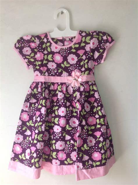 Dress Anak Bulu Motif Kancing 1 jual dress anak dengan motif bunga warna hitam di lapak bolaku dennisgon