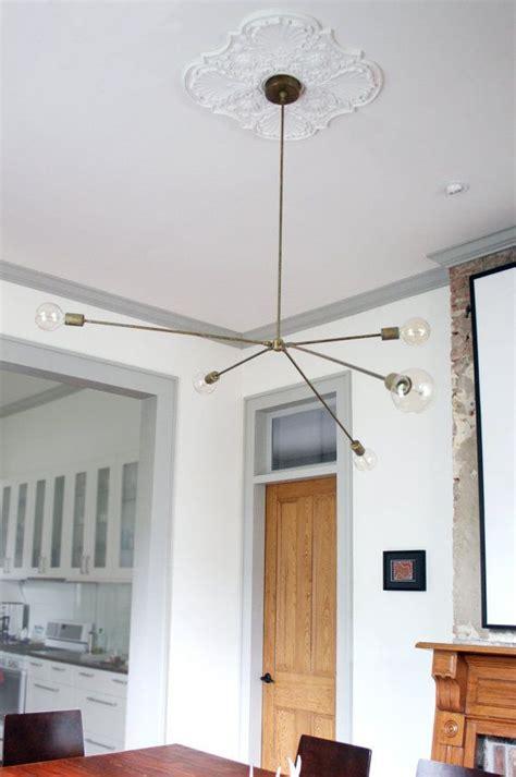 gray walls white trim alva modern brass chandelier