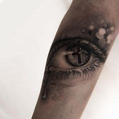 cross tattoo under eye meaning eye with cross reflection ink i like