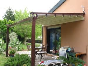 Gibus med system terrace cover offering sun shade over patio dining