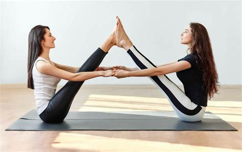 boat pose contraindications 6 fun partner yoga poses to try today journeys of yoga