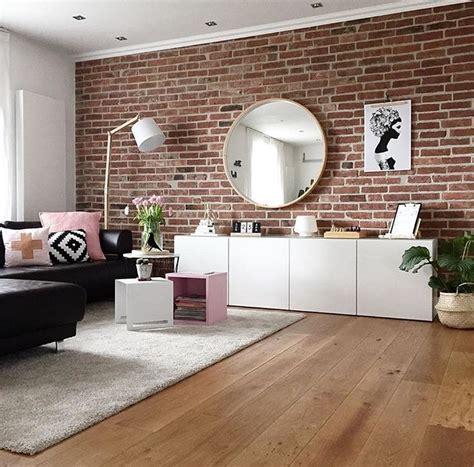 besta couchtisch wohnzimmer teppich besta sideboard schrank steinwand